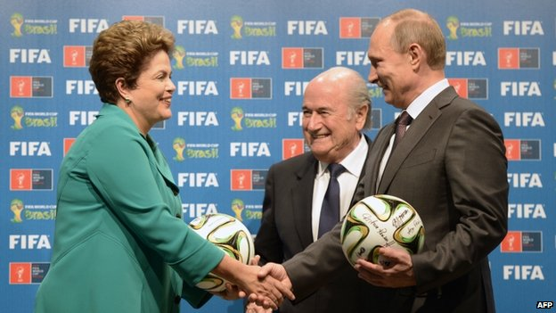 Brazil's President Dilma Rousseff, FIFA President Sepp Blatter and Russia's President Vladimir Putin pose during the handing over of the 2018 FIFA World Cup to Russia