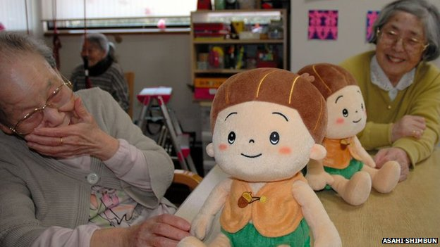 Women at a day centre interact with Kabochan toys
