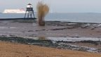 The controlled explosion on a beach in Dovercourt