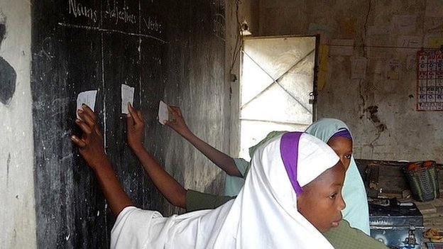 Children at a blackboard in Nigerian school