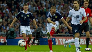 Kenny Miller scoring for Scotland in the 3-2 defeat by England at Wembley in 2013