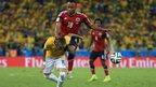 Neymar is fouled by Juan Zuniga