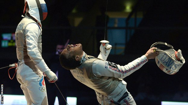 Jamie Davis (right) celebrates after beating Russia's Alexey Cheremisinov (left) during the men's individual foil final match at the European Championships last month