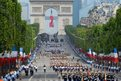 Soldiers march down the Champs-Elysees avenue during the annual Bastille Day military in Paris,