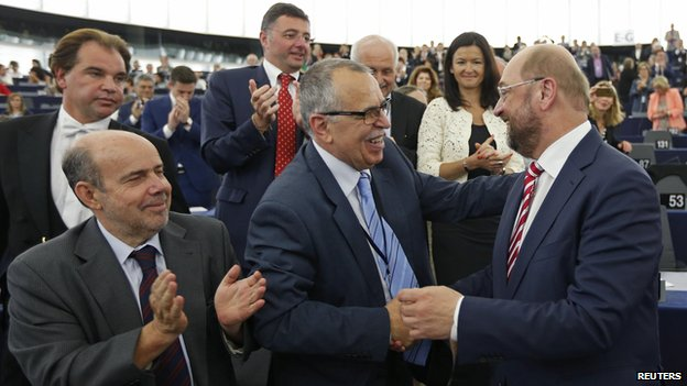 European Parliament President Martin Schulz (right) is greeted after his re-election as president, 1 Jul 14