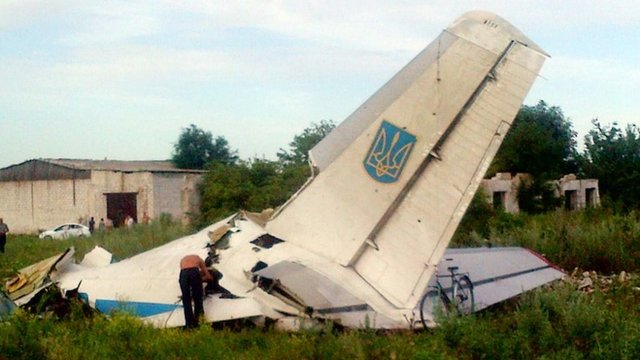 A picture taken on July 14, 2014 displays fragments of a Ukrainian AN-26 transport aircraft near the small eastern village of Davido-Nikolsk, in the Lugansk region, on July 14, 2014
