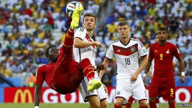 Ghana's Sulley Muntari (L) clears the ball away from Germany's Thomas Mueller (2nd L) and Toni Kroos during their 2014 World Cup Group G soccer match at the Castelao arena in Fortaleza on 21 June 2014