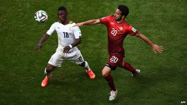 Majeed Waris of Ghana and Ruben Amorim of Portugal compete for the ball during the 2014 FIFA World Cup Brazil Group G match between Portugal and Ghana at Estadio Nacional on 26 June 2014 in Brasilia, Brazil