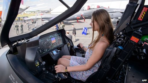 Physics student Katie Ley from Farnborough sits in a mock-up of the Lockheed Martin F-35 Lightning II cockpit at the Farnborough Airshow