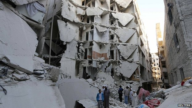 Buildings in Aleppo hit by what activists said was a barrel bomb. 14 July 2014