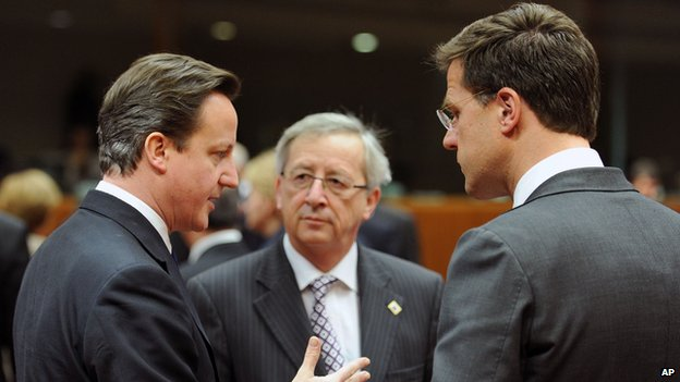 In this Friday, March 11, 2011 file photo, From left, British Prime Minister David Cameron, Luxembourg's Prime Minister Jean Claude Juncker and Dutch Prime Minister Mark Rutte speak with each other during an EU Summit in Brussels