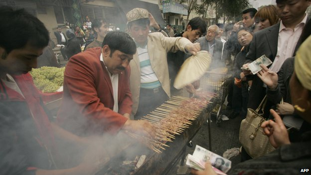 Ethnic Uighur Muslims cook lamb outside the Niujie Mosque in Beijing to celebrate Eid Al-Fitr, the end of Ramadan and month-long fasting on 13 October 2012