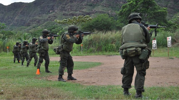 Colombian police officers practice shooting at a base in Pijaos, Colombia, in November 2010