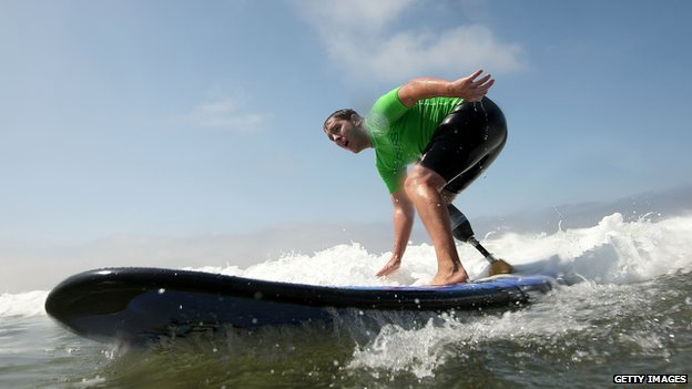 Amputee surfer Ryan West on his surfboard