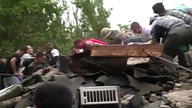 People sifting through rubble