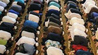 Men praying in a mosque