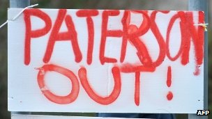 """A sign saying """"Paterson out"""""""