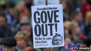 "A placard saying ""Gove out"""