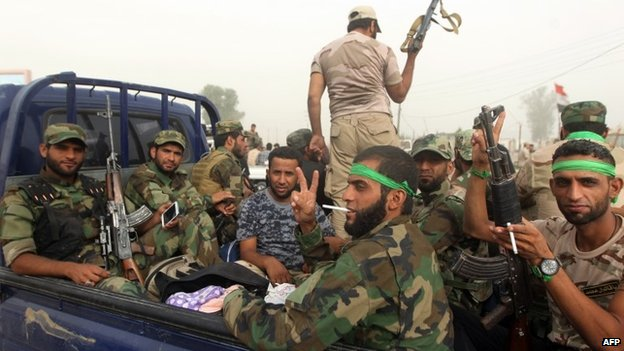 Shia militiamen loyal to Moqtada Sadr in Samarra (13 July 2014)