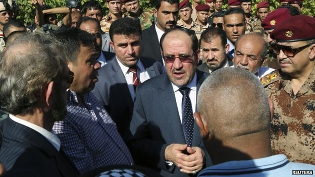 Nouri Maliki attends the funeral of an army commander killed in fighting with Isis-led Sunni rebels in Iraq (7 July 2014)