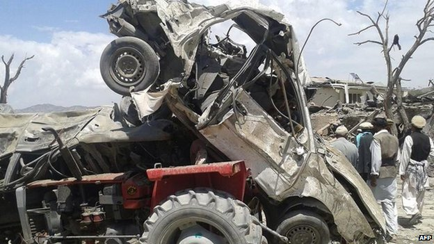 A mangled vehicle at the scene of the blast in Orgun district. Photo: 15 July 2014