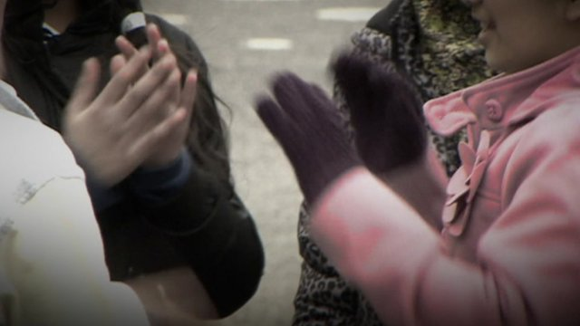 School children clapping hands in a playground