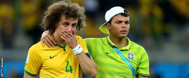 Brazil's David Luiz (L) being comforted by Thiago Silva