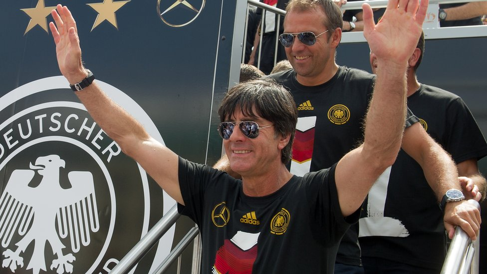 Germany coach Joachim Loew arrives at Brandenburg Gate to celebrate on stage at the German team victory ceremony on 15 July 2014 in Berlin, Germany.