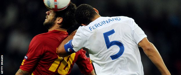Montenegro's Radomir Djalovic (L) vies for the ball against England's Captain Rio Ferdinand (R) during the Euro 2012 Group G qualifying football match at Wembley Stadium in London in October 2010.