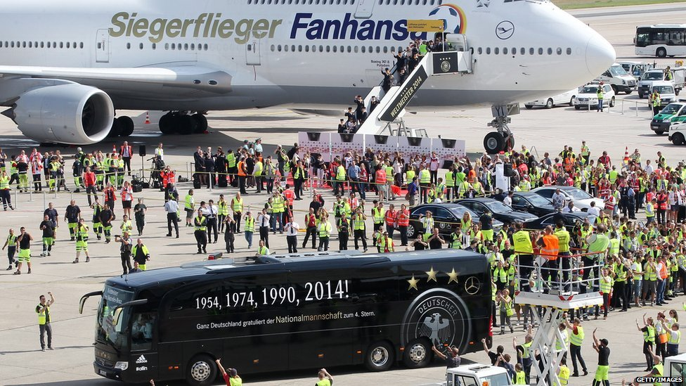 Germany's national football team arrives at Berlin after winning the 2014 FIFA World Cup Brazil at Tegel Airport on 15 July 2014 in Berlin, Germany.