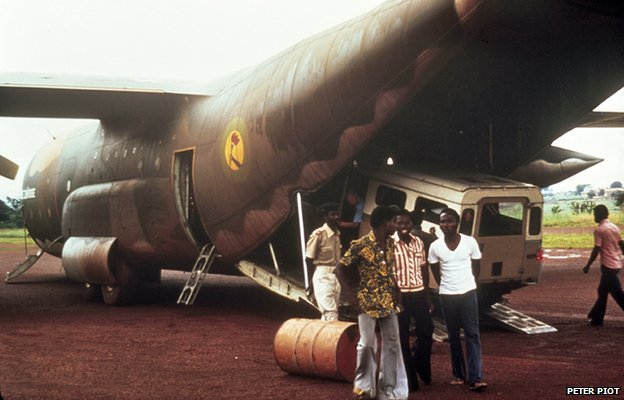 Unloading the Landover from the C-130 plane in Bumba