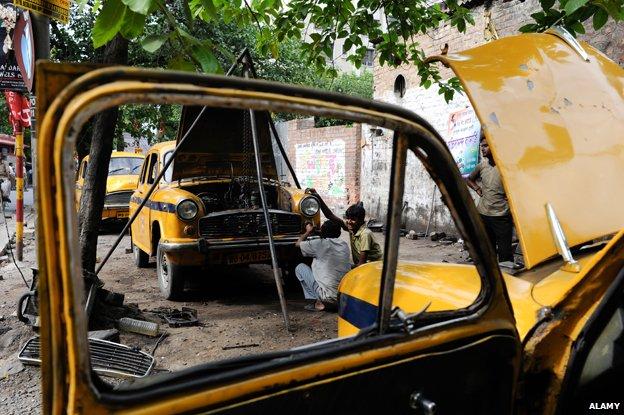 Mechanics repair Ambassador car