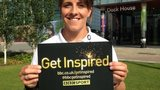 Katie McLean holds a Get Inspired card