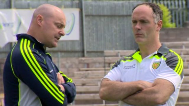 Monaghan manager Malachy O'Rourke talks to Donegal selector Damian Diver during Tuesday's pre-Ulster Final press briefing at Clones