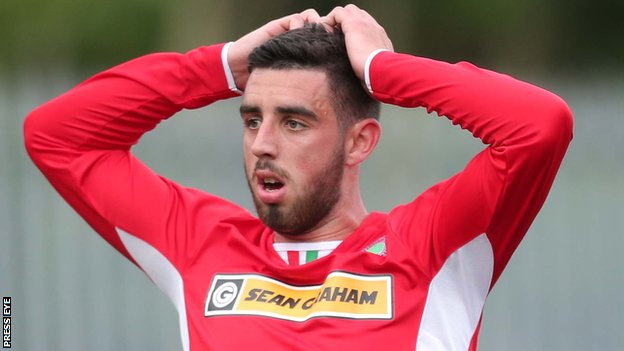 Cliftonville striker Joe Gormley shows his disappointment after missing an early chance at Solitude