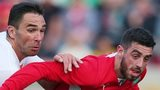Cliftonville striker Joe Gormley attempts to burst away from Debrecen defender Peter Mate in Tuesday's game