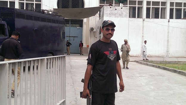 Guards outside central jail Gujranwala, where Saba's father and uncle are incarcerated