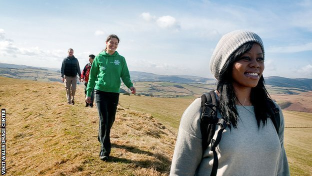 people hill walking outdoors