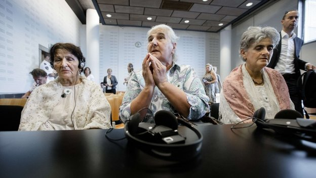 Bosnian women wait prior to the announcement of the verdict in a court case against the Dutch government on on 16 July 2014 in The Hague, Netherlands.
