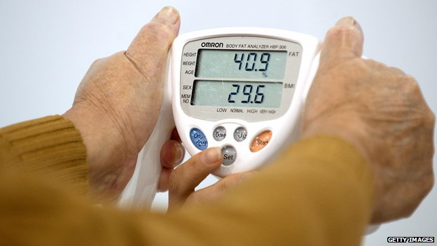 A woman has her Body Mass Index measured in Mexico City on 20 August, 2009.
