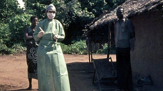 Peter Piot wearing protective gear in Yambuku, 1976
