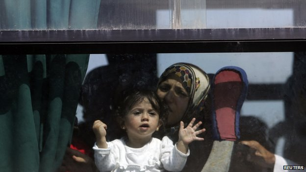 Palestinian family on a bus (16 July 2014)