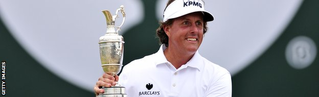 Phil Mickelson holds aloft the claret jug.