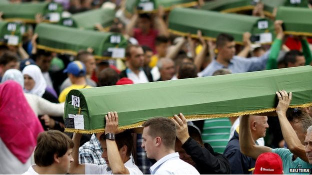 Bosnian Muslims carry coffins during the mass funeral of 175 newly-identified victims from the 1995 Srebrenica massacre, in Potocari Memorial Center, near Srebrenica (11 July, 2014)