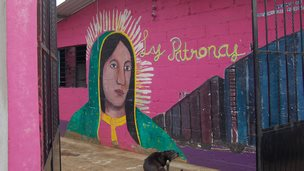 A mural of Las Patronas is painted on wall of their kitchen