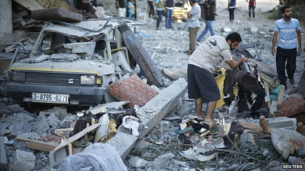 A Palestinian man collected belongings in Gaza City on 16 July 2014