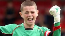 Glentoran Under-12s goalkeeper Paul McLaughlin celebrates a penalty save