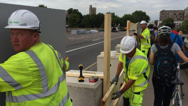 Workmen on Putney Bridge