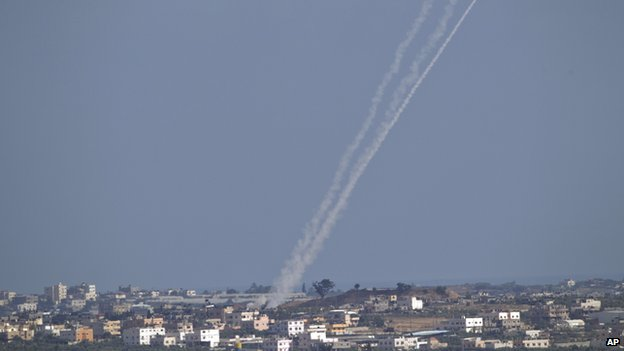 A rocket fired by Palestinian militants from inside Gaza Strip makes its way towards Israel, seen from the Israel Gaza Border, Wednesday (16 July 2014)