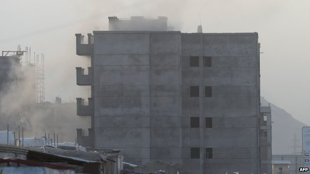 Smoke rises from the building near the airport at the centre of the attack